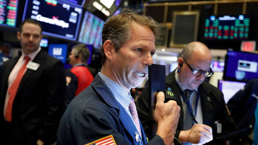 Stocks move lower as investors wait for trade updates