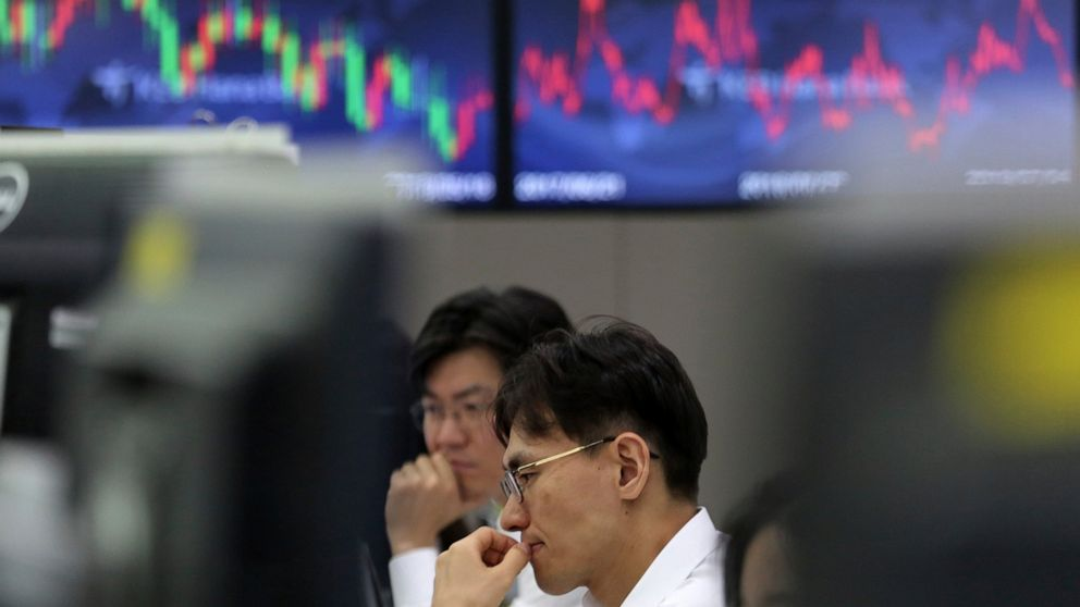 Asian shares mixed after US benchmarks hit record highs