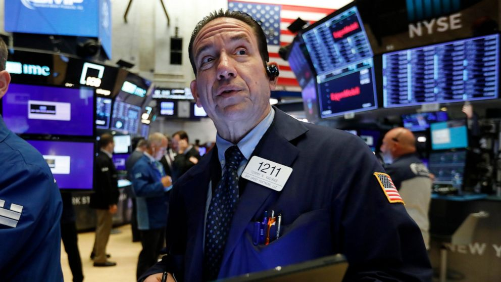 Stocks fall on Wall Street over earnings, trade concerns