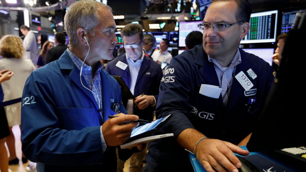 Stocks slide over disappointing earnings reports