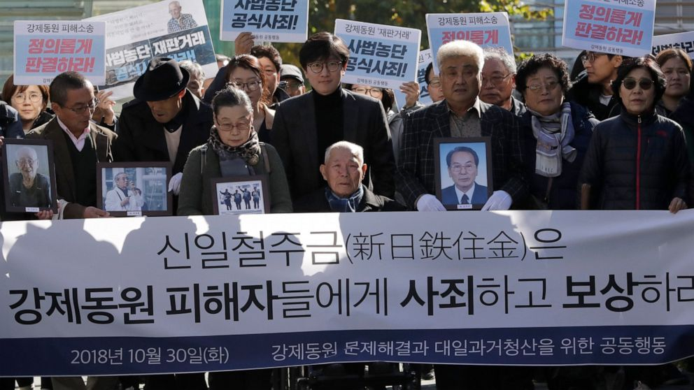 The Latest: SKorea summons Japanese envoy over export curbs