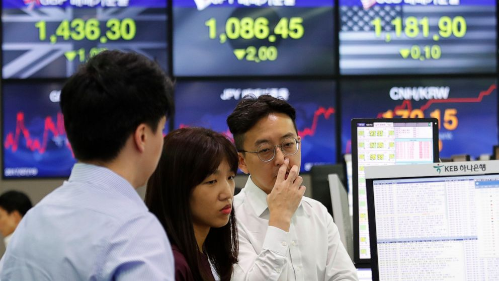 Asian stocks follow Wall Street lower after Fed rate cut