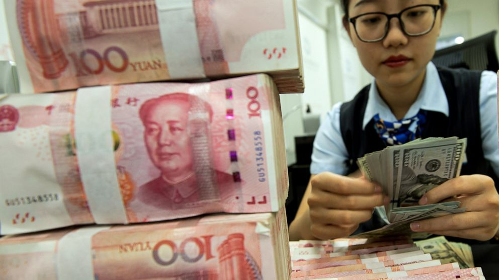 China stabilizes currency but tensions with US remain high