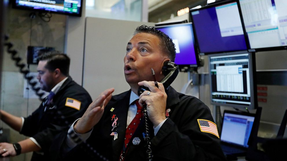 Stocks slide as rate cuts stoke fear of an economic slowdown