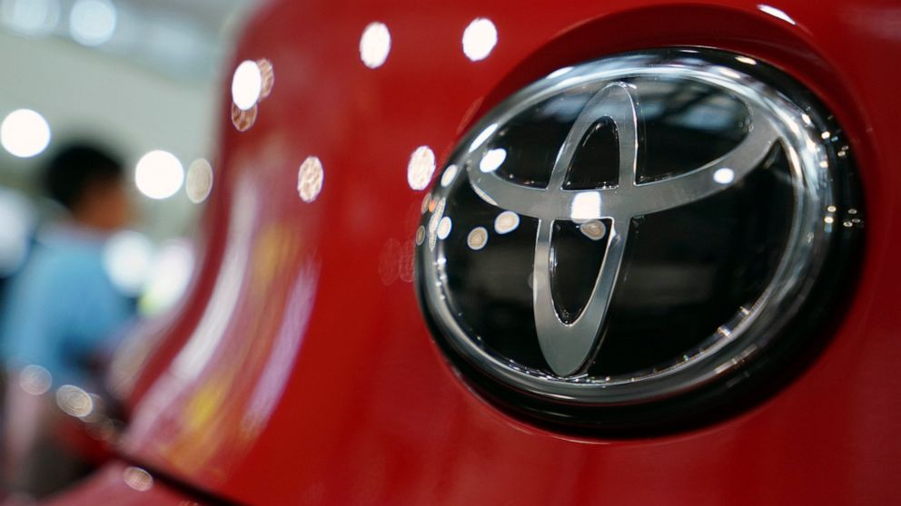 Toyota sees quarterly profit, sales rise, lowers forecast