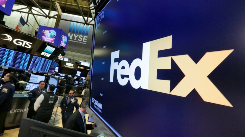 FedEx shares tumbles after company lowers full-year outlook