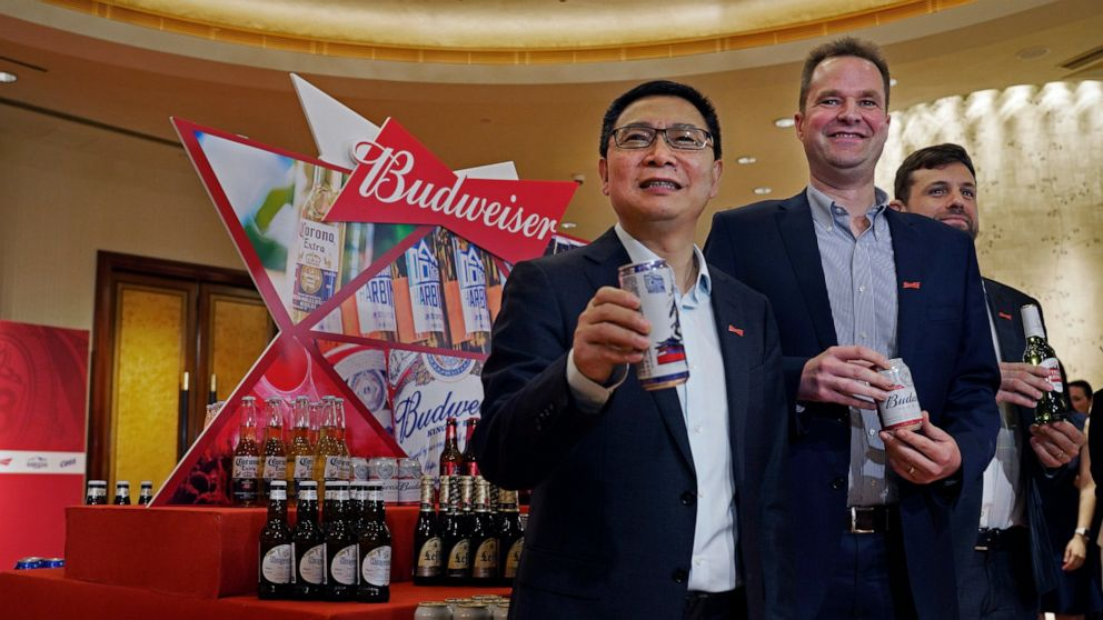 World's top brewer revives listing plans, halves IPO size