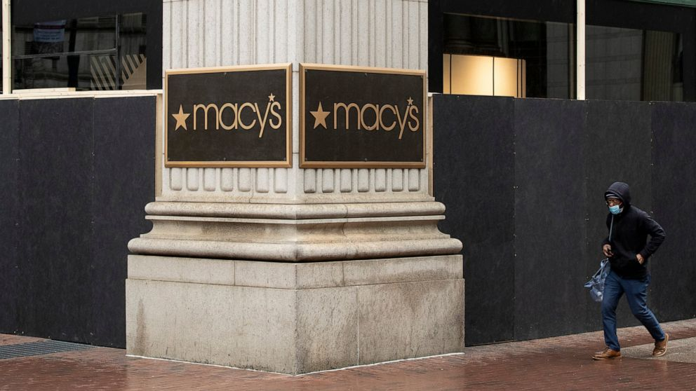 Macy's loses money in 3Q; virus surges into holiday season