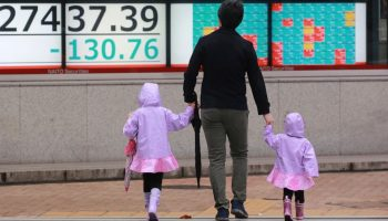 Asian shares mixed as boost from US stimulus package fades