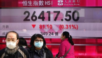 Stocks fall on worries about virus' spread, but pare losses