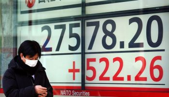 Asian shares track Wall St rally on hopes for stimulus