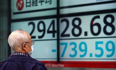 World stock markets fall, US futures point to subdued open