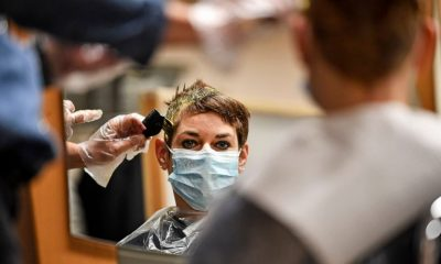 Locks down: German hairdressers reopen despite virus fears