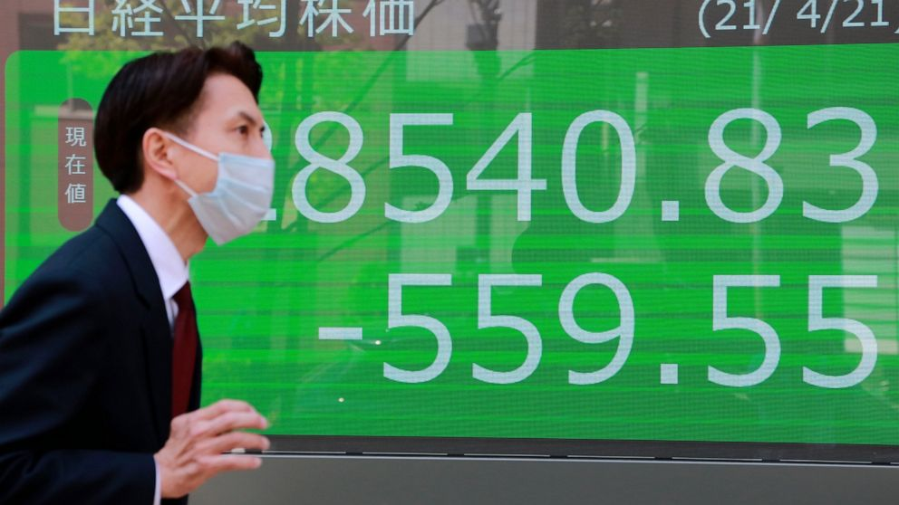 World shares mixed as earnings take center stage