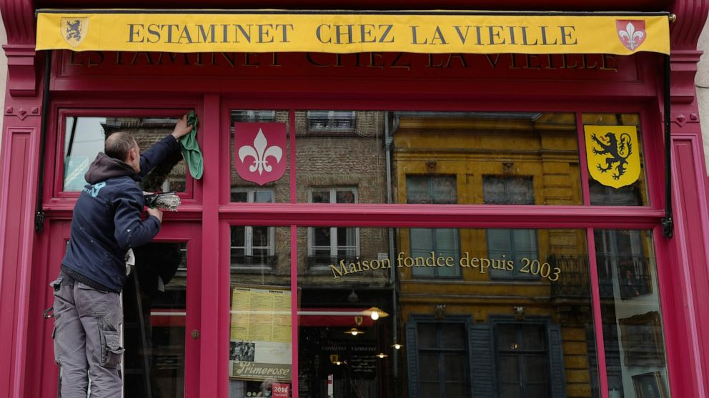 Grand day for the French: Cafe and bistro terraces reopen
