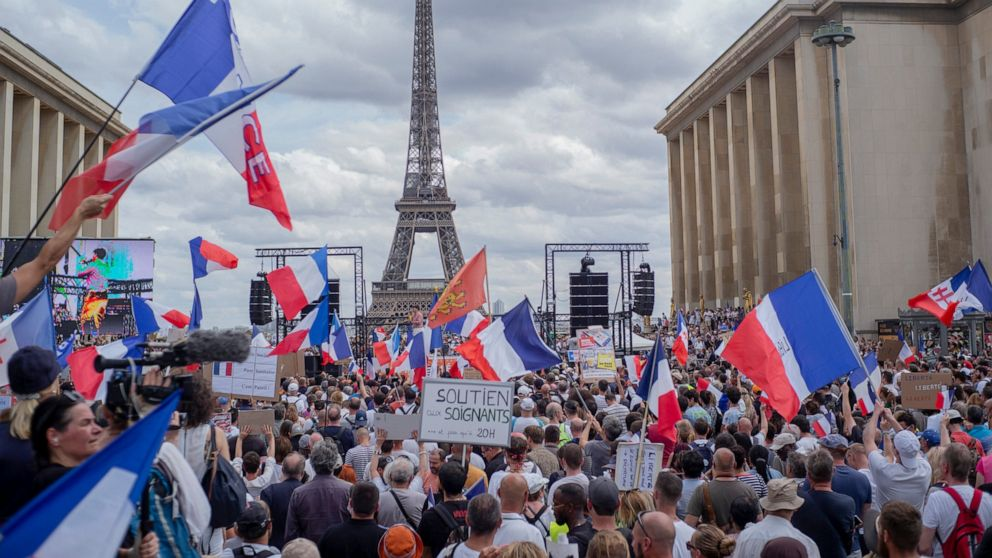 French protesters reject virus passes, vaccine mandate