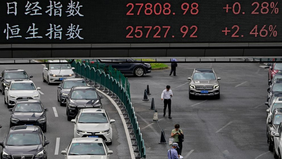 Asian stocks slip following record Wall Street charge