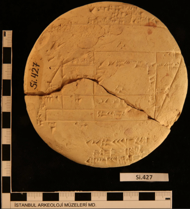 An ancient, cracked clay tablet with