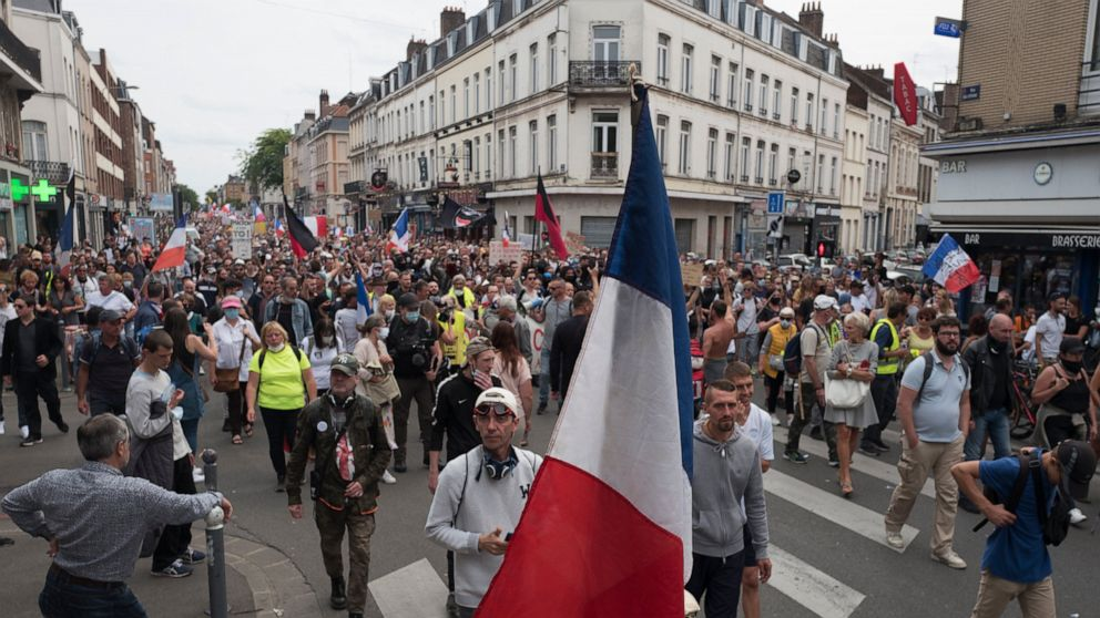 French virus health pass in full use but protests keep going